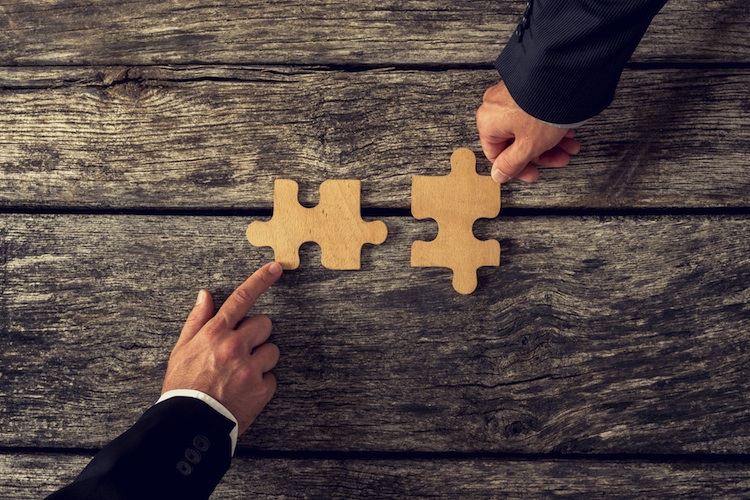 Fusion in Hypoport erweitert Geschäftsbereiche durch Übernahme von FIO Systems