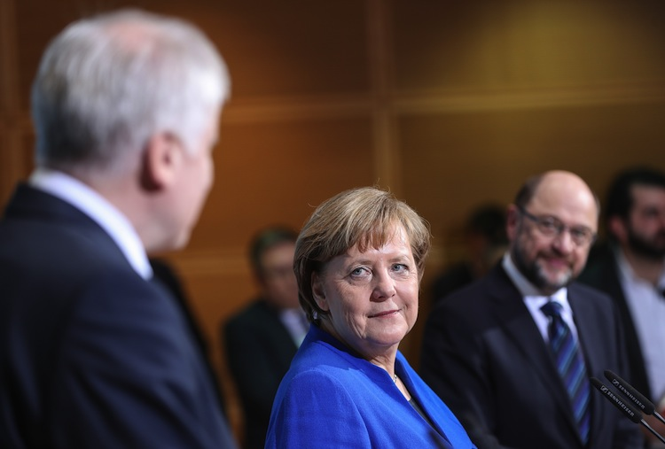 January 12, 2018 - Berlin, Germany - German Chancellor and leader of German Christian Democratic Union (CDU) ANGELA MERKEL (C), leader of German Christian Social Union (CSU) Horst Seehofer (L) and leader of German Social Democratic Party (SPD) Martin Schulz attend a joint press conference after coalition talks at the headquarters of SPD. Friday's meeting achieved a breakthrough in the exploratory talks aimed at forming a new coalition government |