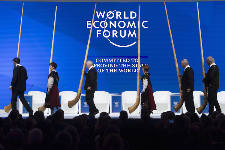 "Alphorn players leave the stage before the opening session in the Congress Hall the first day of the 49th Annual Meeting of the World Economic Forum, WEF, in Davos, Switzerland, Tuesday, January 22, 2019. The meeting brings together entrepreneurs, scientists, corporate and political leaders in Davos under the topic ""Globalization 4.0"" from 22 - 25 January 2019. (KEYSTONE/Laurent Gillieron) 