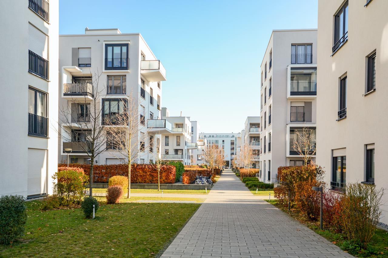 Neubau-Wohnblocks als Symbolbild für Project Projekte