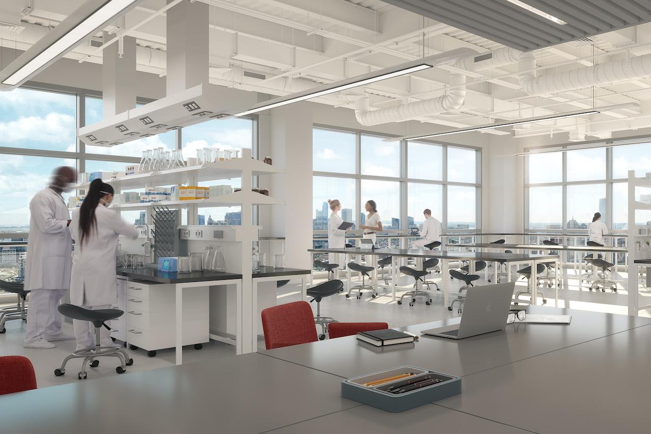 Mitarbeiter in einem Labor mit Schreibtischen, das die Deutsche Finance plant