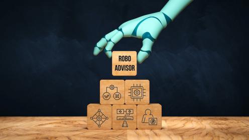 """Eine Roboter-Hand im einem Würfel mit der Aufschrift """"Robo Advisor"""""""