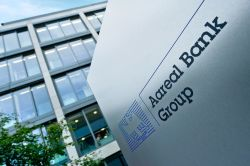 Aareal Bank übertrifft trotz Gewinnrückgang die Prognosen